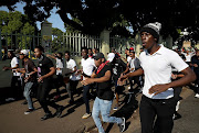 DUT students protest outside the Steve Biiko campus on Monday after a student, Sandile Ndlovu was stabbed in a lecture hall.