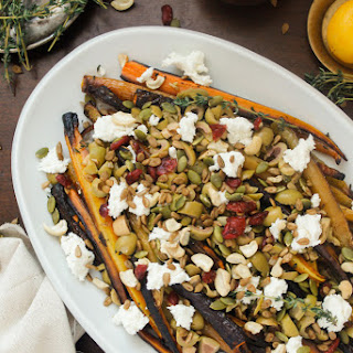 Middle Eastern roasted carrots with olives, goat cheese, salad topper and harissa-preserved lemon dressing.