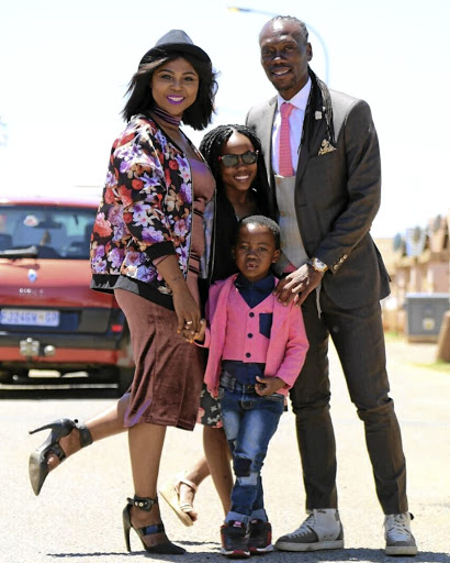 Reneilwe Letsholonyane with his wife Mpho Maboi and their daughter Keneilwe and son Thato.