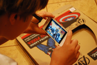 Photo: After we got home and put the pizza in the oven we let the kids play with the SuperHero AR app and the pizza box. When you hold the phone over the app a virtual city appeared.