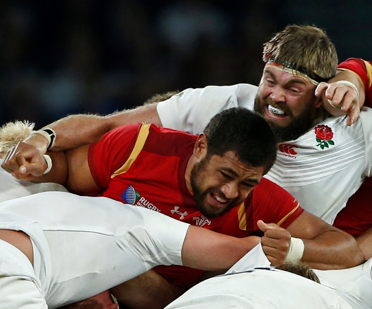 Toby Faletau in action against England. Picture: REUTERS