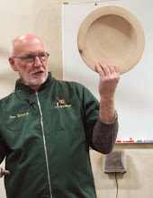 Photo: Our demonstrator for the evening is Tom Wirsing, visiting the area from his home in Colorado.  Tom is a past President of AAW.  He specializes in platters and bowls with an emphasis on cutting and scraping techniques to avoid tearout and excessive sanding.  He loves to work with figured bigleaf maple.