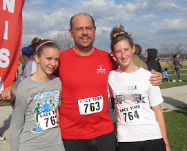 Photo: Dad with his daughters who all finished strong today