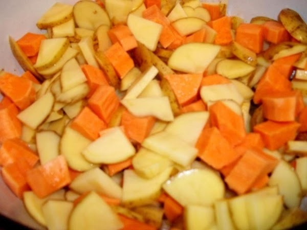 Add potatoes to the pot and stir to combine with onion and bacon.