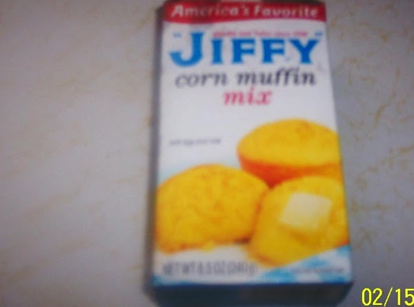 Pre-heat oven to 375. Mix the Jiffy mix for muffins. Set aside. Cut each hot dog...