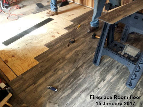 Vinyl plank flooring getting installed at LP Painted Ponys