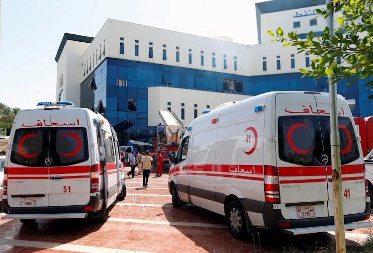 Ambulances wait outside the headquarters of Libyan state oil firm National Oil Corporation after an attack, in Tripoli, Libya, September 10 2018. Picture: REUTERS