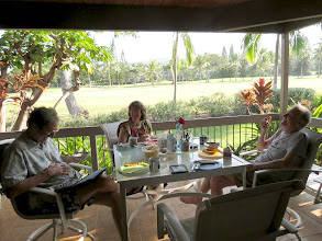 Photo: Kind of an ideal start to the day: fresh fruit, crossword puzzles, and a little e-reading on the veranda overlooking Kona Country Club golf course