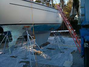 Photo: Solid gray areas are already stripped, inspected, repaired, and coated in new barrier coat. Our goal with this round of bottom work is to end up with the entire hull, below the waterline, repaired and sealed in new barrier coat.