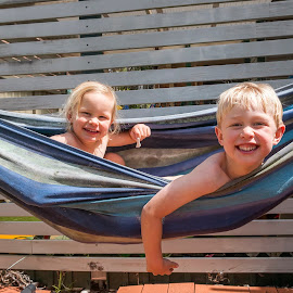 In The Hammock by Geoffrey Wols - Babies & Children Toddlers ( children, girl, boy, brother, sister, hammock,  )