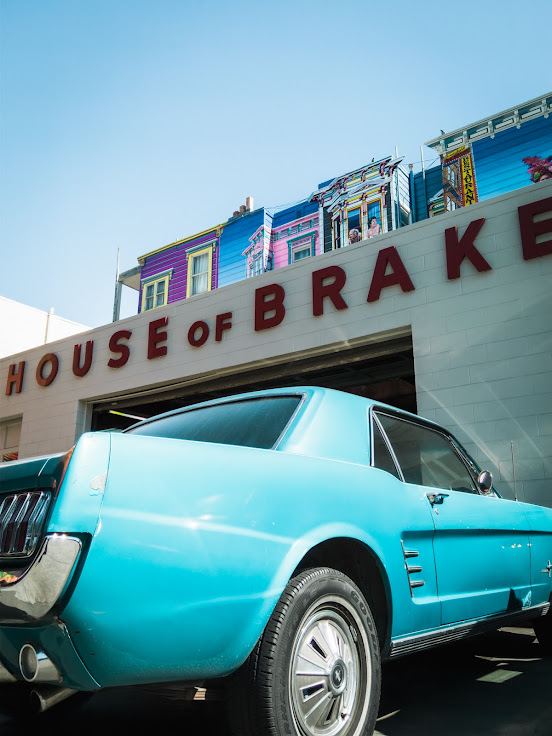 Mustang in front of House of Brakes - Carnival Mural