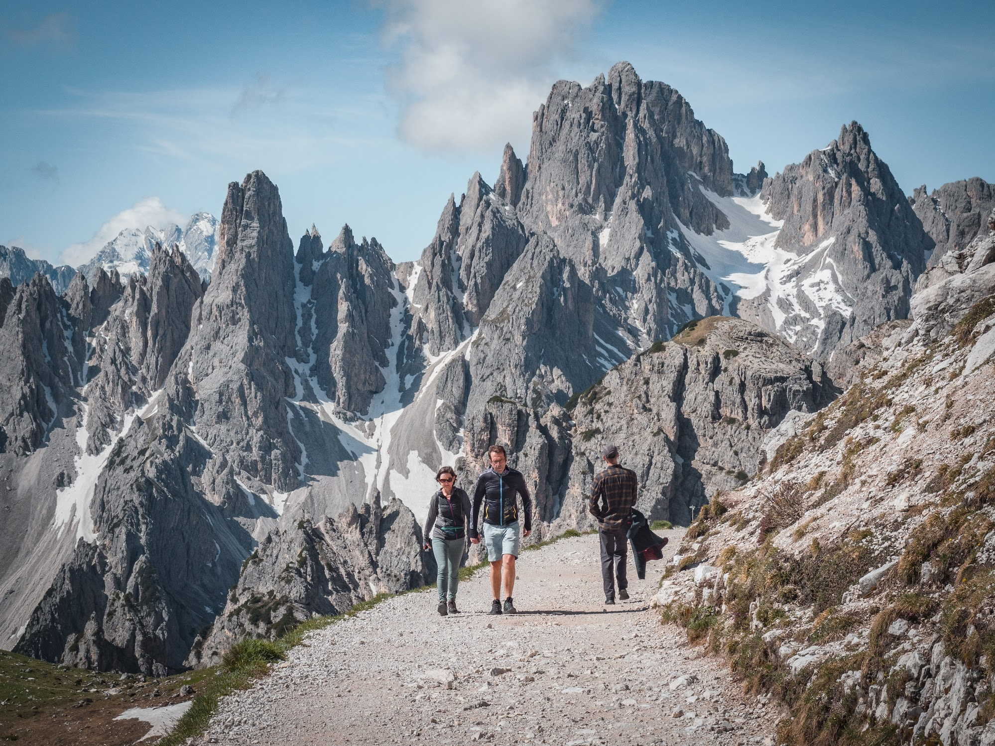 Hiking near Tre Cime de Lavaredo, with Misurina Peaks on the background.