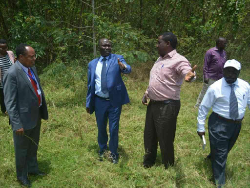 WIld Life PS Fred Segor (C) inspects land for the proposed LVBC headquarters.