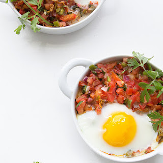 Baked Eggs with Shredded Chicken and Salsa.