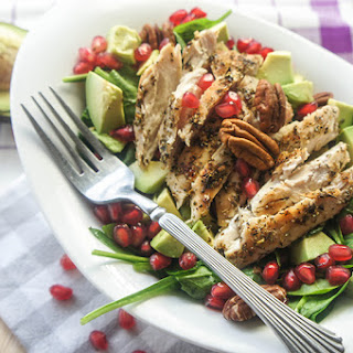 Chicken Spinach Salad with Avocado, Pomegranate, and Pecans.