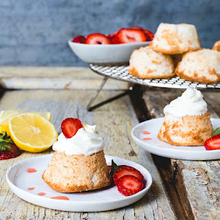 Mini Grain-Free Angel Food Cakes with Lemon Whipped Cream and Juicy Strawberries.