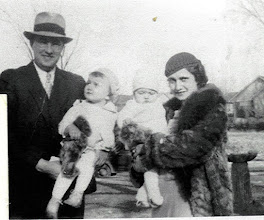Photo: Dad holds me and Mother holds Kathleen in the early 30's.