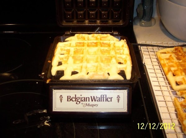 Whip egg whites.Till stiff.Add to the flour mixture.LET sit.Heat waffle maker.