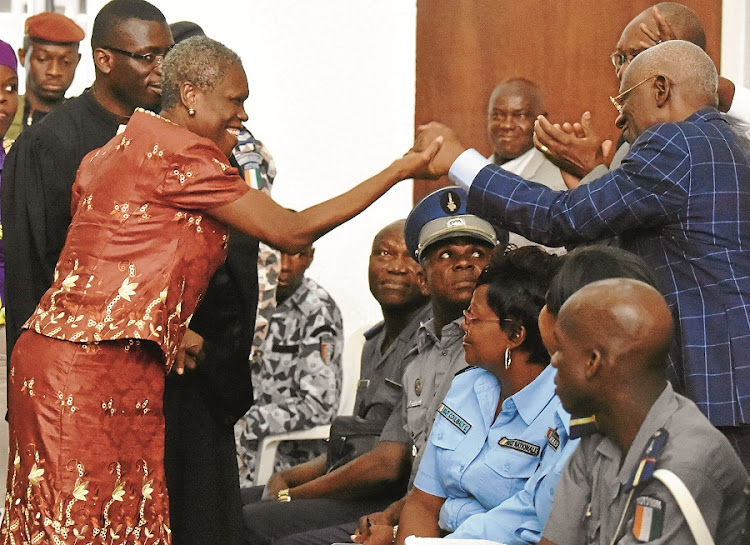 Côte d'Ivoire's   former first lady, Simone Gbagbo, greets her supporters during the opening hearing of her trial in Abidjan on charges of crimes against humanity for her alleged role in electoral violence in 2010. Picture: GALLO IMAGES/AFP/ISSOUF SANOGO