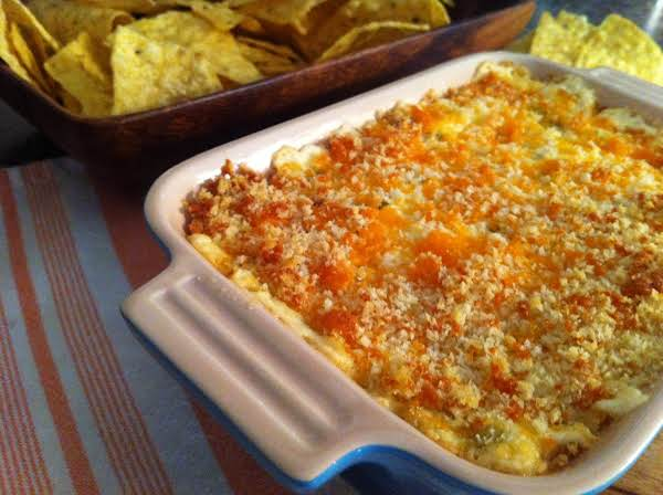 Dip In A Blue Serving Dish With Tortilla Chips In The Background.