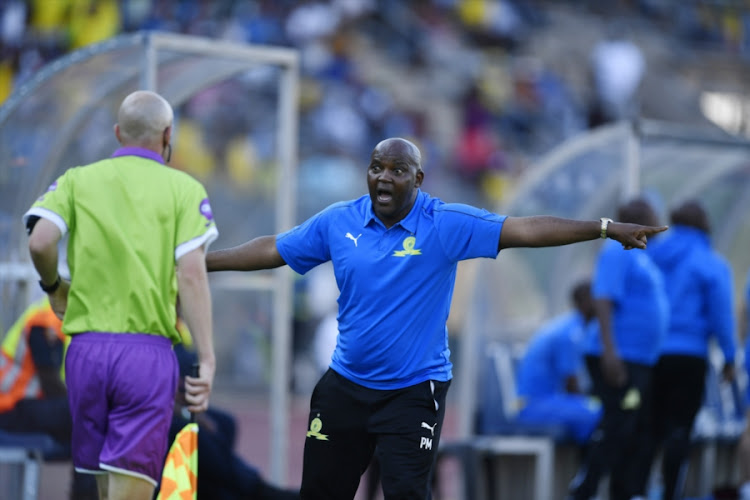 Mamelodi Sundowns' coach Pitso Mosimane remonstrates with the linesman during a 1-1 Absa Premiership draw at home to Bidvest Wits at Lucas Moripe Stadium in Atteridgeville, west of Pretoria, on October 07, 2018.