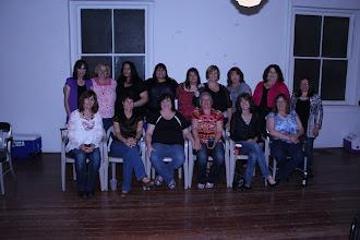 Photo: Left to right, front row: Stephanie (Faust) Leeper, Danna (Delaney) Inglee, Sheila (Banks) Lawson, Patti Quarles, Brenda (Grasmick) Dwyer, Brenda (Eirhart) Maestas.  Back row: Ethie (Fipps) Hagaman, Helen (Tyscka) Haley, MIchelle Oviedo, Kathy Martinez, Valerie (Torrez) Pfingston, Elaine Hedgecoke, Delores (Wright) Nettles, Christine (Childers) Martinez, Paula (Fernandez) Garcia