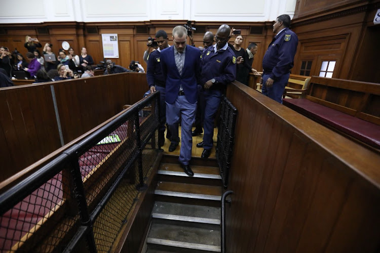 Henri van Breda hand-cuffed and escorted by police