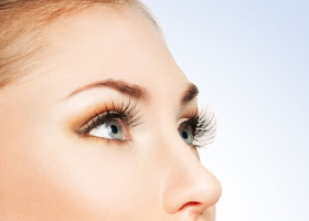 a photo of a ladies eyes with eyelash extensions and eyeliner after having gone through threading