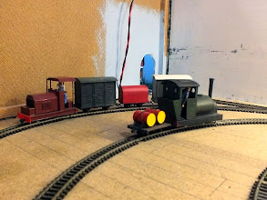 "Photo: 023 A glimpse behind the backscenes at one of the two fiddle yards revealed a little saddle tank locomotive that at least some parts started out as a Hornby Desmond loco and a rather attractive 15"" gauge version of the 2ft gauge Ransomes and Rapier locomotive preserved at Amberley Museum – expanded slightly to accommodate the popular and ubiquitous Kato tram chassis ."