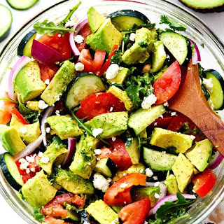 Avocado, Tomato and Cucumber Arugula Salad.