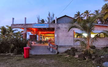 Photo: The Aitutaki Game Fishing Club had the only bar on the island not aimed at the tourist set and they were happy to welcome us boaters.  If you look closely you'll see the bar in the back  -it's built into a shipping container!