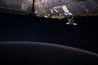 """Photo: Orion's Belt Rises Through Earth's Atmosphere