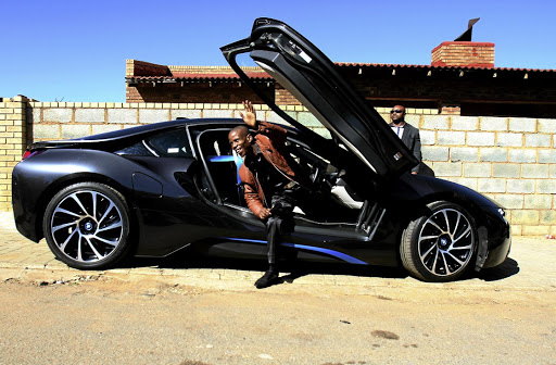 Pastor Mboro gets out of his luxury car in Orlando East, Soweto.