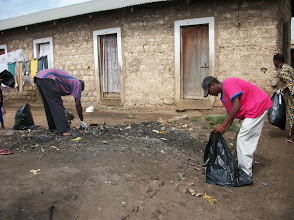 Photo: Sept - 17th - Community Trash Removal Youth working in residential areas