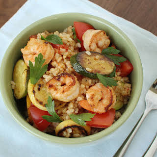 Brown Rice Bowl With Buttery Shrimp, Tomato and Summer Squash.