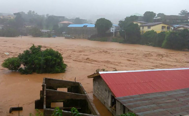 This handout picture released on August 14, 2017, by Society 4 Climate Change Communication Sierra Leone, shows flooded streets in Regent near Freetown. The death toll from massive flooding in the Sierra Leone capital of Freetown climbed to 312 on August 14, 2017, the local Red Cross told AFP.