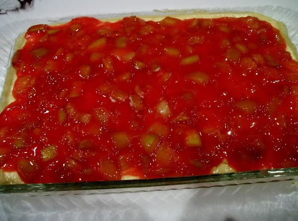 Spread rhubarb filling on top of cake batter.