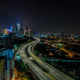 Kuala Lumpur at Night 09 by Daimasala Abdullah - Uncategorized All Uncategorized ( petronas, sunrise, city, dusk, financial, skyline, scenery, malaysia, scenic, twilight, scene, towers, view, modern, road, street, cityscape, avenue, place, highway, landmark, skyscrapers, park, twin, architecture, shopping, kl, famous, suria, reflection, business, metropolis, lumpur, night, center, mall, malaysian, centre, downtown, water, klcc, kuala, district, sunset, evening )