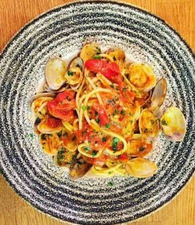 gourmet pasta with tomato and capers