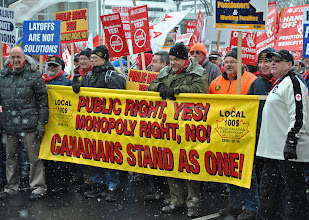 Photo: Trade unionists and supporters of various affiliations prepare to begin the march on a cold day in Hamilton, Ontario.