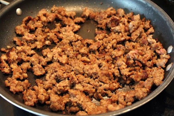 Crumbled sausage in a frying pan.