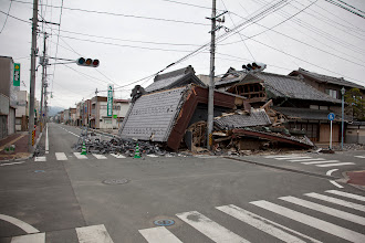 Photo: May 6, 2011. Odaka, Fukushima, Japan. Unlike many other towns where rapid recovery is taking place, the town of Odaka is like a time-capsule where the immediate after effects of 3/11 have been preserved. Having been quickly evacuated after the radiation leaks, many earthquake devastated buildings and roads remain in a state of disrepair.