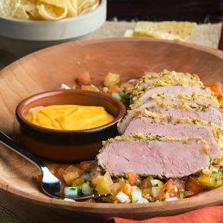 Nacho-Crusted Pork Tenderloin with Pico de Gallo and Nacho Sauce.