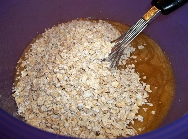 Next add the corn syrup, vanilla, honey, melted butter. Mix well.  Add the oats and...
