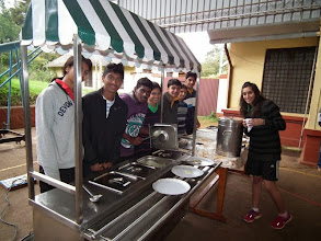 Photo: Those cheerful present students who served us our food