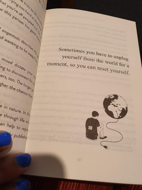 page from book with self care quote