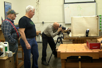 Photo: Bob Grudberg and Jeff Tate watch Gallery photographer Mike Colella focusing in on the item of interest.