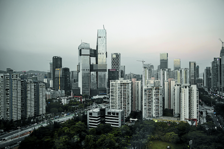 Rising high: The tall buildings centre left are Tencent's new headquarters in Shenzhen, China. Picture: BLOOMBERG/QILAI SHEN