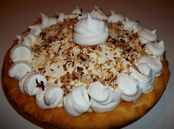 Sprinkle with toasted coconut. I piped some extra cool whip around the edges for...