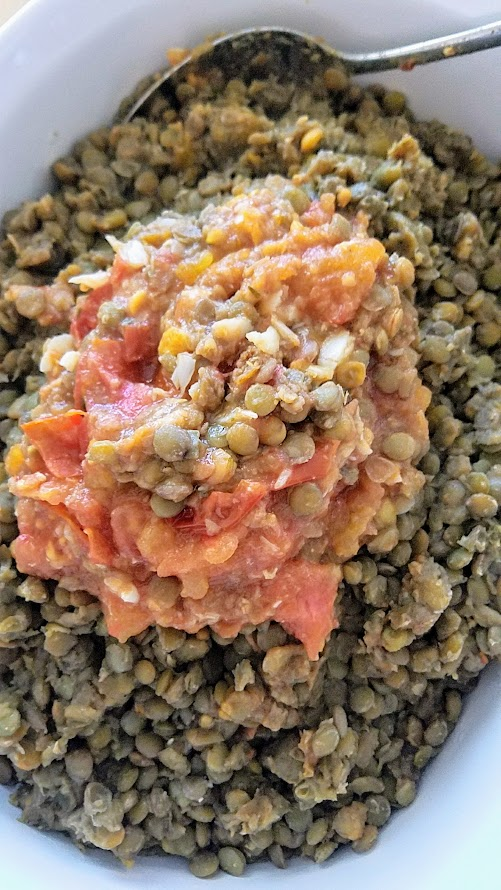 Recipe for Lentils with Roasted Tomatoes and Horseradish - cook the lentils with a tomato and garlic cloves, and when the lentils are done mush the tomatoes and garlic into a paste and mix into the lentils